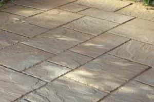 What is the technology of laying paving slabs on sand